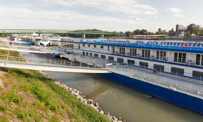 Danube river and passenger touristic ships moored in Bratislava, Slovakia