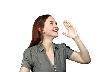 girl on a white background smiling holding her hand in front of her and screaming or calling someone