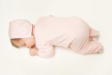Portrait of adorable newborn baby girl sleeping