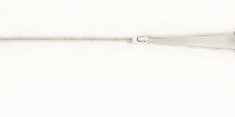 A zipper opening on a bright white background with lots of negative space.