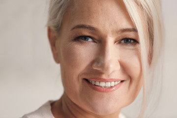 Portrait of smiling mature woman at home, closeup