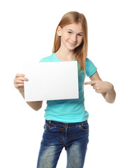 Cute girl with blank sheet of paper for advertising on white background