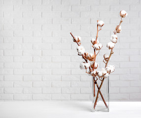 Cotton flowers in vase on table