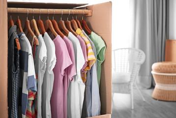 Wardrobe box with clothes indoors, closeup