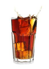 Splash of cola in glass on white background