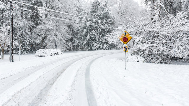 Street Stop Sign on Snow covered road
