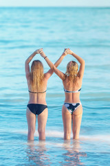 the concept of female friendship. girls holding crossed hands