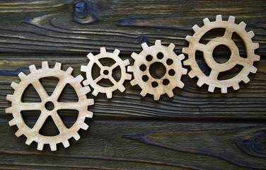 gears on a wooden background. The concept of business, creative, logical thinking. Teamwork. Logical background. gears of natural wood.
