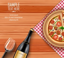 Pizza with bottle of wine and a glass on wooden table