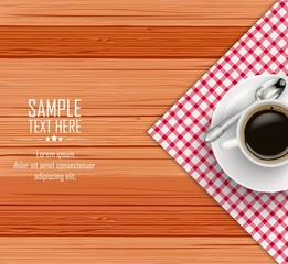 Top view of white coffee cup and a saucer on wooden table