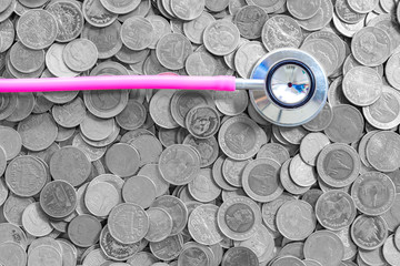 background business concept thai coin,Stethoscope Health finance money coin on white background
