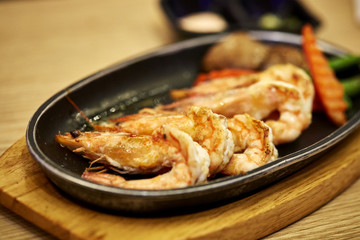 Japanese seafood. Fried spicy shrimps with herbs
