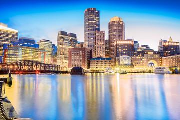 The Boston skyline at night, located in Fan Pier Park, Boston, Massachusetts, USA.