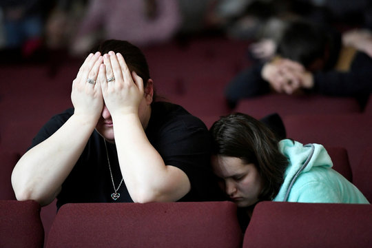 Tiffany Moreland and her daughter Emily Moreland attend a prayer vigil for students killed and injured after a 15-year-old boy opened fire with a handgun at Marshall County High School in Marion, Kentucky
