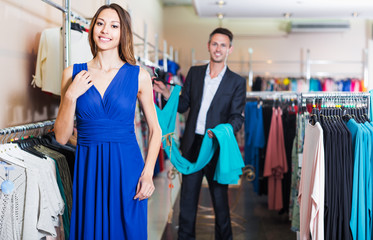Female customer fitting new dress