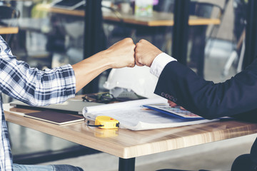 Business Partners Trust in Team Giving Fist Bump to Greeting Start up project Contractor.Businessman Teamwork are Partnership in Office Team Meeting with Hands together. Industry Business Work Concept