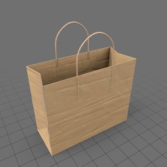 Wide paper shopping bag with handles