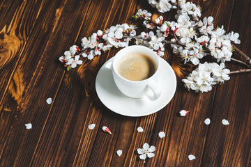 Apricot spring flowers and coffee cup