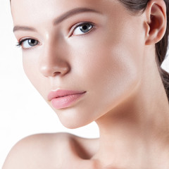 Young beautiful woman with clean perfect skin close-up