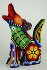 Traditional Mexican Huichol art bead coyote from Jalisco region of Mexico, common souvenir