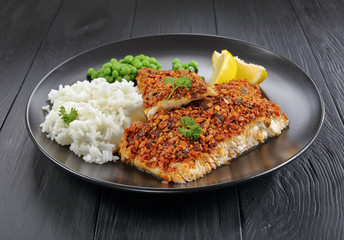 white fish fillet with rice and lemon