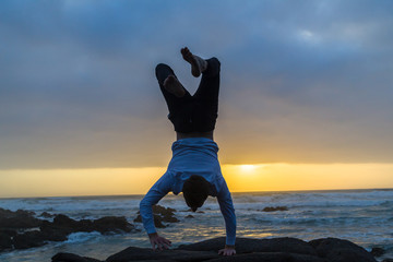 Man Handstand Balance Ocean Rocks Silhouetted Dawn