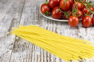 Tomatoes 'Ciliegini' and spaghetti