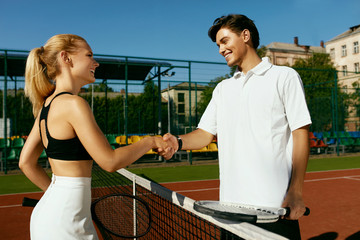 Tennis. Man And Woman Shake Hands Before Playing Tennis