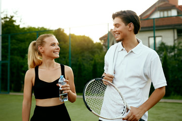 Happy Couple After Playing Tennis