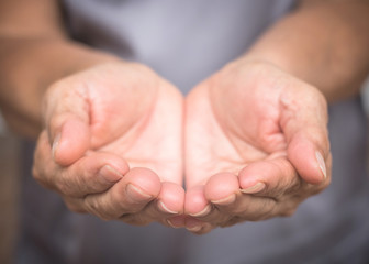 Charity donation concept with grandparent or old woman person's empty hands in asking or receiving gesture