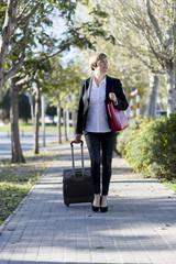Elegant businesswoman walking on the street