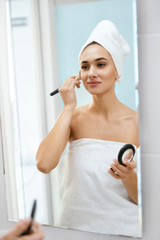 Woman Doing Makeup In Bathroom In Morning.