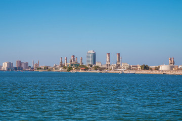 Ras Al Khaimah during sunny day . View to beautiful bay with harbour in background