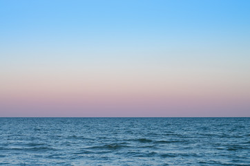 Wall Mural - pink sky of sunset on the sea horizon.
