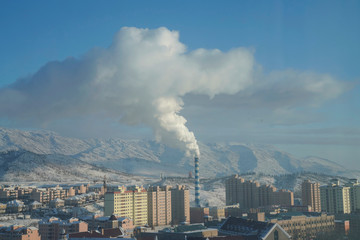 Smoke is seen from a chimney in Altay, Xinjiang Uygur Autonomous Region