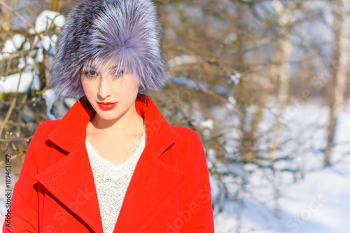 8e95d6d21114 Beautiful young girl in red coat winter christmas clothes