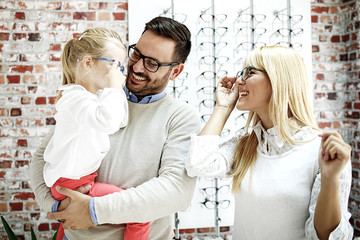Father and Daughter Choosing Glasses