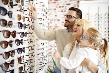 Father and Daughter Choosing Glasses Wall mural