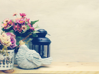 home decoration with candle lanterns and flowers bouquet