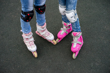 Two Young girl on rollerblading