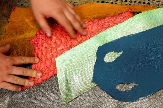 Shoemaker Koppitz works on pigmented fish leather in workshop in Grafing