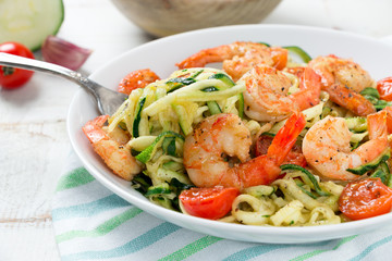 Delicious zucchini noodles  with cherry tomato and prawns