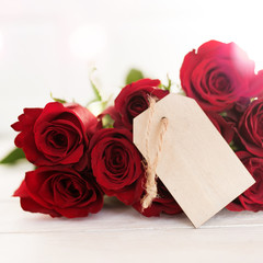 Bouquet of red roses with a label