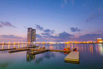 Ras Al Khaimah by night. View to beautiful bay with harbour in background