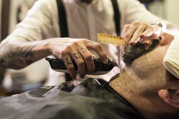 modern hairdressing.Preparing goatte shave with shaving machine