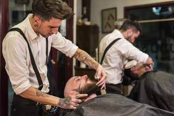 Barber shop. Modern hairdresser cutting beards. Jaen, Spain.