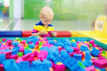 Wall Mural - Kids play. Construction toy blocks. Child toys