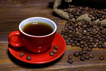 Coffee in a red cup, coffee beans in a bag