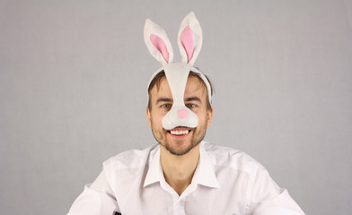 man in the mask Easter rabbit looking at camera and smile