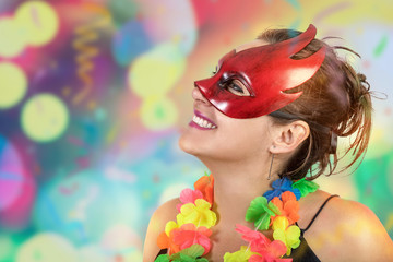 Girl having fun jumping and dancing carnival with mascara necklace of flowers and fan at a party